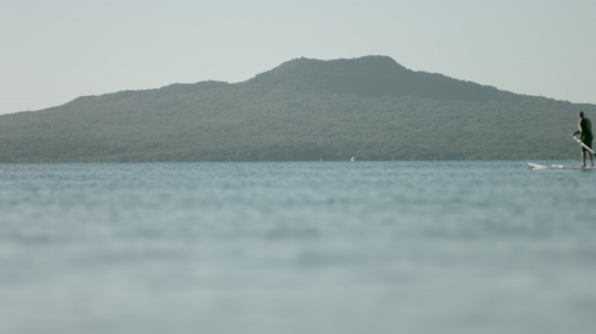 Rangitoto with stand up paddle-boarder - stock video